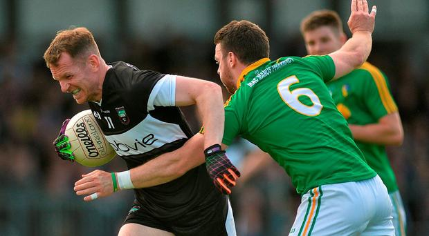 Mark Breheny of Sligo in action against Gary Reynolds of Leitrim during the GAA Football All-Ireland Senior Championship Round 2A match between Sligo and Leitrim at Markievicz Park in Sligo. Photo by Ray Ryan/Sportsfile