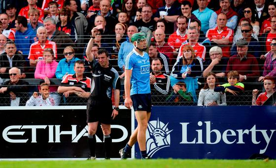 Chris Crummey of Dublin is shown a red card by referee Paul O'Dwyer during the GAA Hurling All-Ireland Senior Championship Round 1 match between Cork and Dublin at Pairc Ui Rinn in Cork. Photo by Seb Daly/Sportsfile