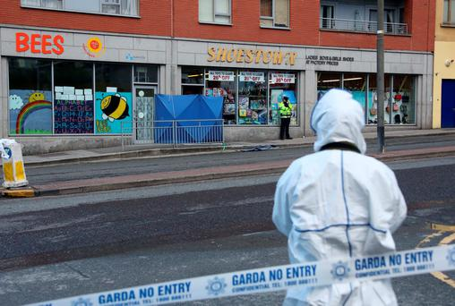 LAWLESS STREETS: Gardai outside the Shoestown shop on Bridgefoot Street, Dublin, where David Douglas was shot dead. Photo: Colin Keegan, Collins Dublin