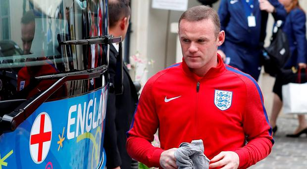 A grim faced Wayne Rooney boards the England bus. Photo: Lee Smith/Reuters
