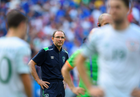 Ireland manager Martin O'Neill consoles his players after defeat to Francein Lyon, France. Photo: Stephen McCarthy/Sportsfile