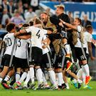 Germany players celebrate winning the penalty shootout
