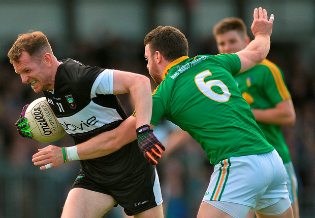 Mark Breheny of Sligo in action against Gary Reynolds of Leitrim. Photo: Ray Ryan/Sportsfile