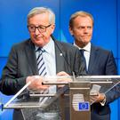 European Commission President Jean-Claude Juncker, left, and European Council President Donald Tusk have been talking a tough stance over Brexit
