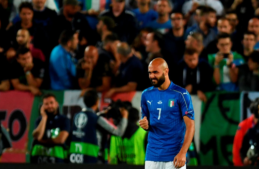 Italy's forward Simone Zaza reacts after missing his penalty. Getty Images
