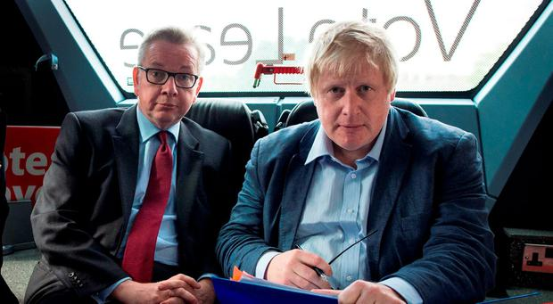 File photo dated of Michael Gove and Boris Johnson (right) on the Vote Leave campaign bus: Stefan Rousseau/PA Wire