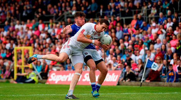 3 July 2016; Colm Cavanagh of Tyrone is tackled by Conor Moynagh of Cavan during the Ulster GAA Football Senior Championship Semi-Final Replay between Tyrone and Cavan at St Tiemach's Park in Clones, Co Monaghan. Photo by Ramsey Cardy/Sportsfile