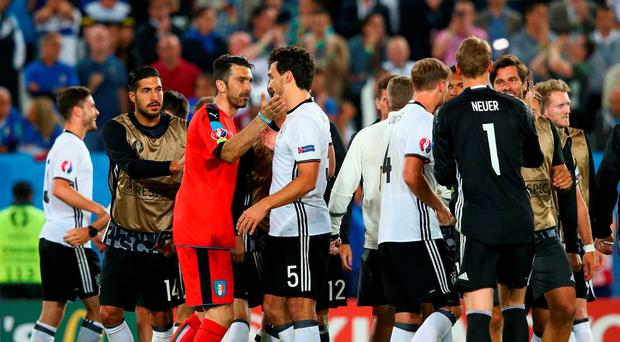 Gianluigi Buffon of Italy and Mats Hummels of Germany applaud each other after the UEFA EURO 2016 quarter final match between Germany and Italy last night