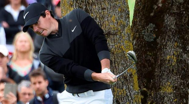 Rory McIlroy plays a shot from an awkward lie at the third hole during the final round of the French Open. Photo: Dominique Faget/Getty Images