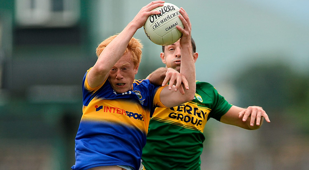 Tipperary's Josh Keane is put under pressure by Kerry's Aidan Aidan O'Mahony during the Munster SFC final in Killarney. Photo: Sportsfile