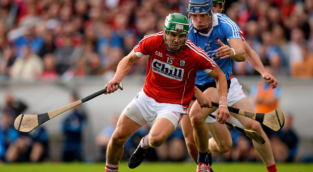 Cork's Alan Cadogan attempts to get away from Dublin's Eoghan O'Donnell during their clash in Pairc Ui Rinn. Photo: Sportsfile