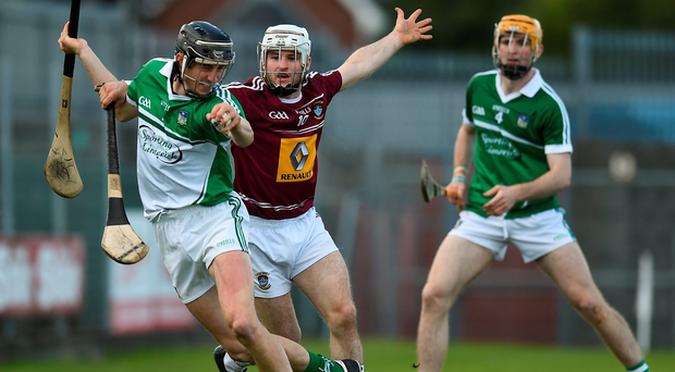 Limerick goalkeeper Nickie Quaid prepares to clear under pressure from Alan Devine of Westmeath. Photo: Sportsfile