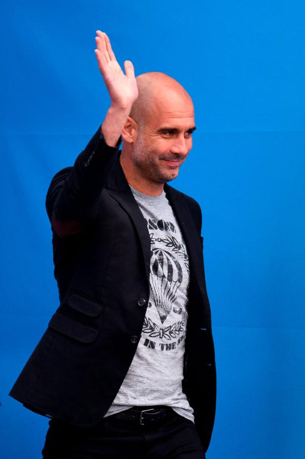 Pep Guardiola waves at Manchester City supporters during his question and answer session at the club's academy. Photo: Oli Scarff/GettyImages
