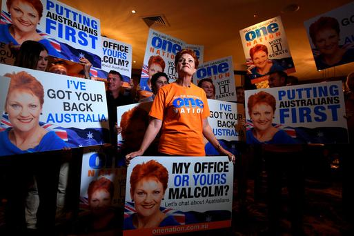 Australian politician and leader of the One Nation Party Pauline Hanson holds an election placard as she stands with supporters during a function on election night in the city of Ipswich, west of Brisbane, Australia. AAP/Dan Peled/REUTERS