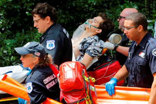 Medics remove a man who was injured after an explosion in Central Park in Manhattan, New York, U.S., July 3, 2016. REUTERS/Andrew Kelly