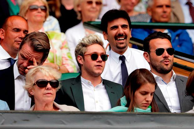 Niall Horan watches the action on centre court on day seven of the Wimbledon Championships at the All England Lawn Tennis and Croquet Club, Wimbledon