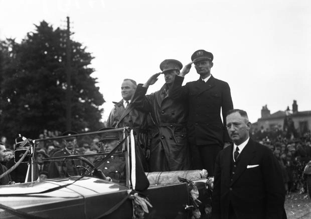 The three members of the Bremen crew, standing in open-topped car, L-R: Herman Kohl, James Fitzmaurice and Baron von Hunefeld. (Part of the Independent Newspapers Ireland/NLI Collection)