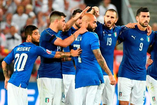 Italy's forward Simone Zaza is consoled after missing a spot-kick during a penalty shoot-out in the Euro 2016 quarter-final football match between Germany and Italy at the Matmut Atlantique stadium in Bordeaux