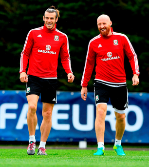 Gareth Bale and James Collins share a joke during Wales training ahead of their game against Portugal Photo: Stu Forster/Getty Images