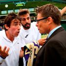 Pablo Cuevas of Uraguay (L) and Marcel Granollers of Spain (R) argue with the match referee during the Men's Doubles third round match against Jonathan Marray of Great Britain and Adil Shamasdin of Canada on day seven of the Wimbledon Lawn Tennis Championships at the All England Lawn Tennis and Croquet Club in London, England. (Photo by Julian Finney/Getty Images)