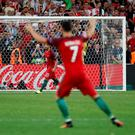 Cristiano Ronaldo celebrates after Ricardo Quaresma's converted penalty Photo: REUTERS/Yves Herman