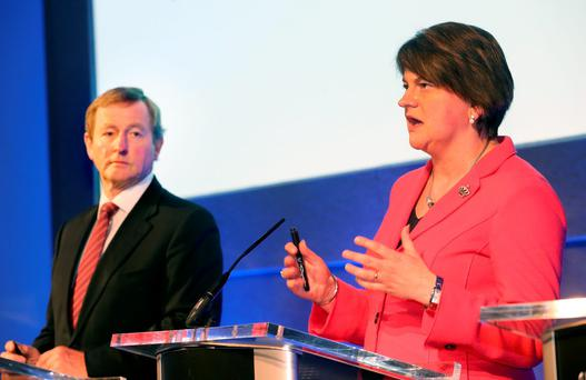 Northern Ireland First Minister Arlene Foster speaks at the North South Ministerial Council Meeting at Dublin Castle this morning as Taoiseach Enda Kenny looks on. Photo: Tony Gavin
