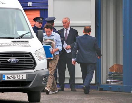 Documents are removed from a storage unit in Naas on foot of a court order. Picture Colin Keegan, Collins Dublin.