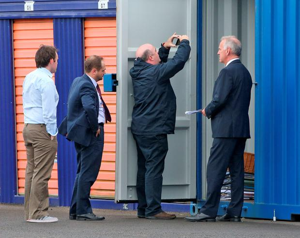 David Hall, the new Console chief executive, takes a photo of the contents of the unit. Photo: Collins