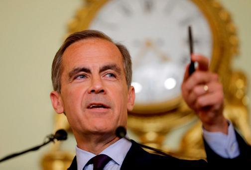 Governor of the Bank of England Mark Carney gives a press conference at the Bank of England in the City of London where he signalled interest rates could be cut over the summer to bolster the economy after the Brexit vote. Photo: Matt Dunham/PA Wire