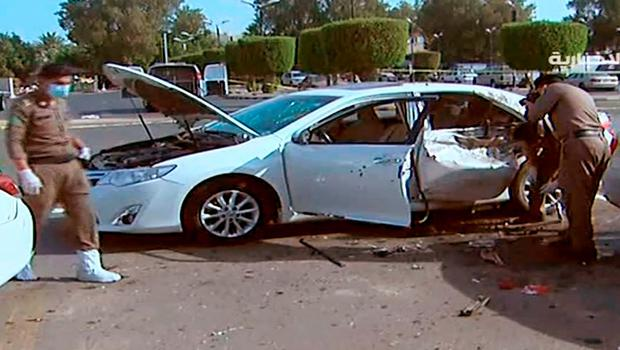 TV grab from footage released by Al-Ekhbariya shows Saudi security forces investigate the scene of an explosion in Jeddah, Saudi Arabia. A suicide bomber carried out an attack early Monday near an American diplomatic site in the western Saudi city of Jeddah, according to the Interior Ministry. Photo: Al-Ekhbariya via AP