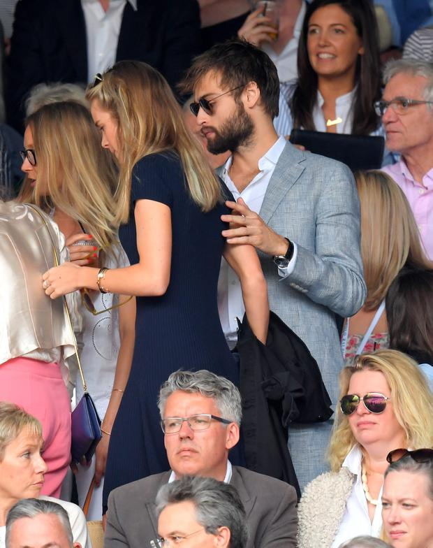 Cressida Bonas and Douglas Booth attend day eight of the Wimbledon Tennis Championships at Wimbledon on July 04, 2016 in London, England. (Photo by Karwai Tang/WireImage)