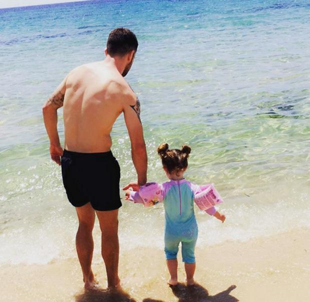 Robbie Brady with daughter Halle in Sardinia. Picture: Kerrie Harris/Instagram