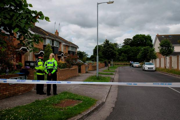 Gardai at the scene of a shooting at the Dun Emer housing development in Lusk. Photo: Niall Carson/PA Wire