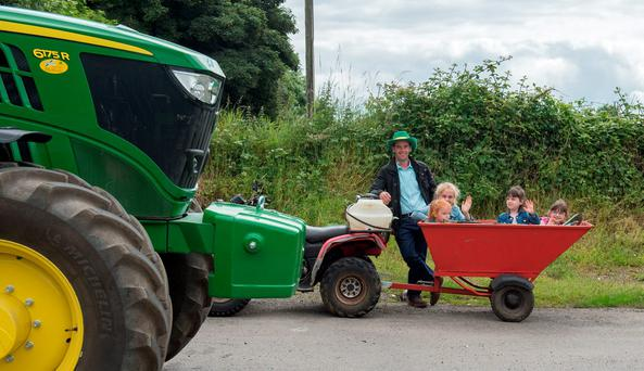Con McManus provided some spectator transport at Bradley Farm Leggagh,Castletown, Co Meath The third annual tractor run in memory of Wayne Smith, beloved son of Patsy and Deirdre. All proceeds are going to 'Join Our Boys' campaign - www.joinourboys.org Photo: Barry Cronin.