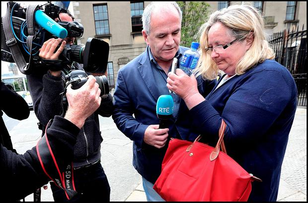 Former Console Chief Executive Paul Kelly's wife Patricia leaving the four Courts. Credit: Steve Humphreys