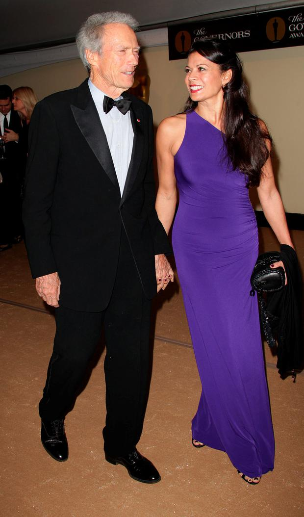 Clint Eastwood and his Dina Ruiz attend the Academy of Motion Picture Arts and Sciences' second annual Governors Awards at the Grand Ballroom, Hollywood and Highland on November 13, 2010 in Los Angeles, California. (Photo by Frederick M. Brown/Getty Images)