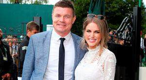 Brian O'Driscoll and Amy Huberman arrive on day six of the Wimbledon Championships.