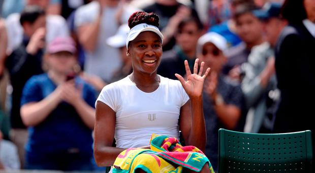 Venus Williams waves to the crowd after beating Yaroslava Shvedova on day eight of the Wimbledon Championships at the All England Lawn Tennis and Croquet Club, Wimbledon. Anthony Devlin/PA Wire