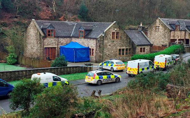 Police outside a house on Sunny Bank Road in Helmshore, Lancashire as a murder investigation has been launched after Sadie Hartley was found dead. Pat Hurst/PA Wire