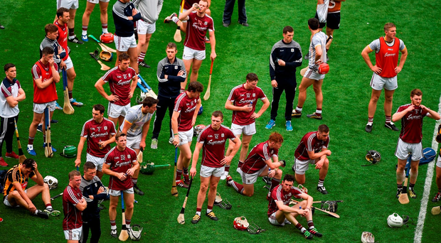 Galway players show their disappointment as the Bob O'Keeffe Cup is presented to Kilkenny after the Leinster Hurling final at Croke Park. Photo: Ray McManus/Sportsfile