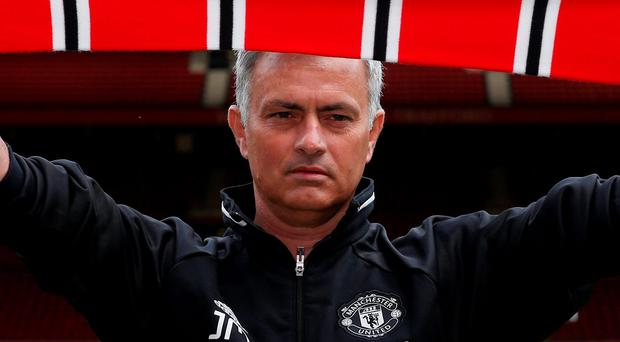 New Manchester United manager Jose Mourinho poses ahead of the press conference REUTERS/Andrew Yates