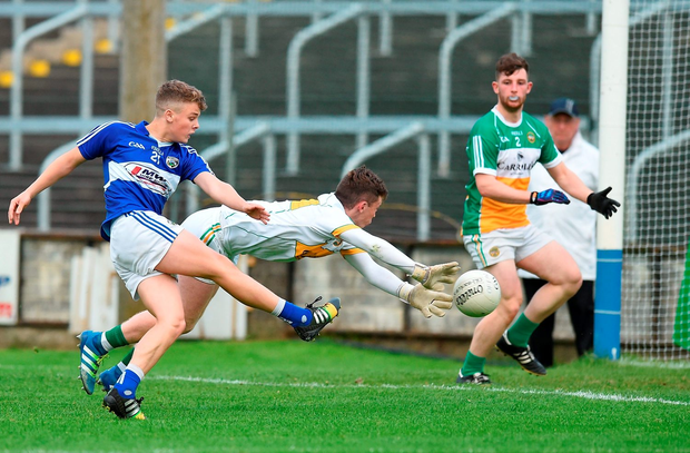 Evan Lowry of Laois shoots past Offaly goalkeeper Barry Rohan to score his side's only goal of the game, Photo: David Maher/Sportsfile