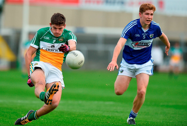 Michael Mooney of Offaly in action against Shane Bolger of Laois. Photo: David Maher/Sportsfile