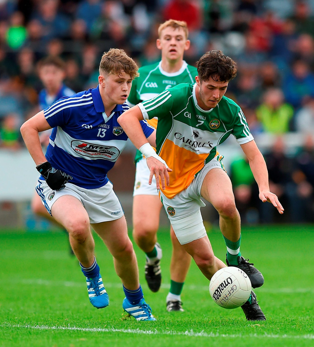 Dan Molloy of Offaly in action against Johnny Kelly of Laois. Photo: David Maher/Sportsfile