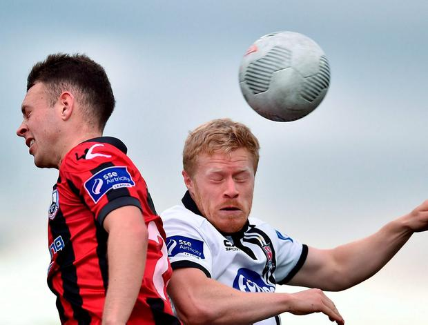 Dundalk's Daryl Horgan and Philip Gannon clash in the air. Photo by Paul Mohan/Sportsfile