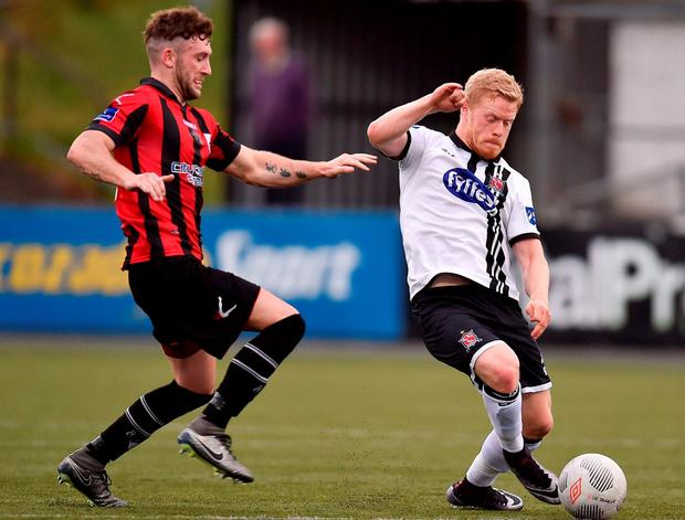 Daryl Horgan is closed down quickly by Longford's Lee Duffy. Photo by Paul Mohan/Sportsfile