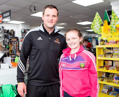 Donegal captain and shop owner Michael Murphy with Hailey Wolf, who is home from New York. Photo: Joe Boland (North West Newspix)