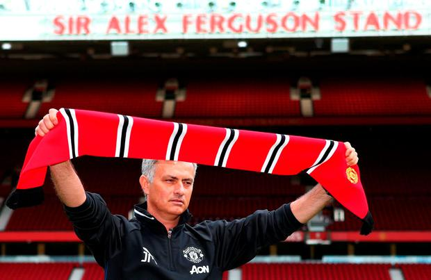 Jose Mourinho is pictured at Old Trafford under the Sir Alex Ferguson stand GETTY