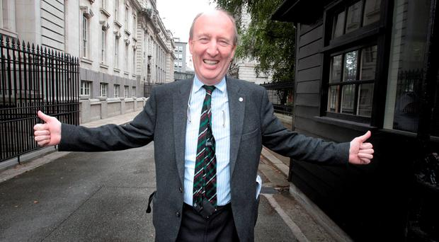 A delighted Shane Ross arriving for yesterday's Cabinet, where Enda Kenny conceded a free vote on the Fatal Foetal Abnormalities Bill. Photo: Tom Burke