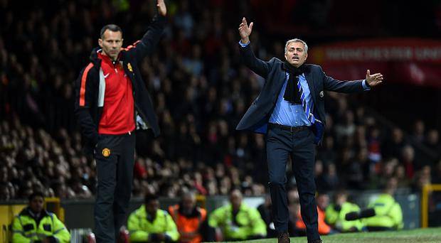 MANCHESTER, ENGLAND - OCTOBER 26: Chelsea Manager Jose Mourinho (R) protests during the Barclays Premier League match between Manchester United and Chelsea at Old Trafford on October 26, 2014 in Manchester, England. (Photo by Laurence Griffiths/Getty Images)
